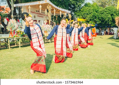 Beautifully women wear traditional clothes dancing in a unique manner of northern Thai style in order to worship and sacred city pillar shrine event.31 January 2019, Lampang, THAILAND.