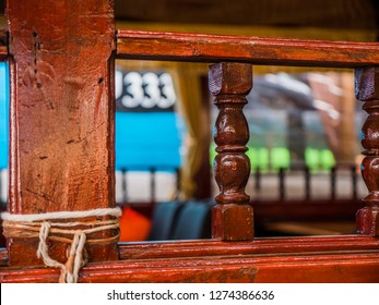 Beautifully worked old wooden railing, and an old blue painted wall in the background with number 333.