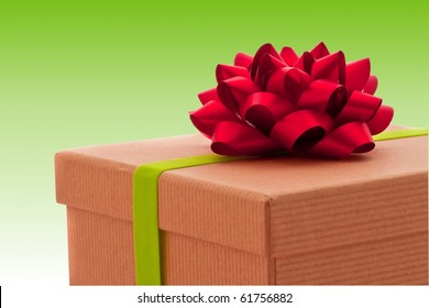 Beautifully wrapped present on green background, red bow