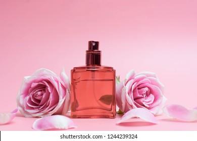 Beautifulperfume bottles on pink background