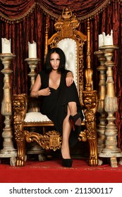 Beautiful,sexy , brunette woman sitting on throne