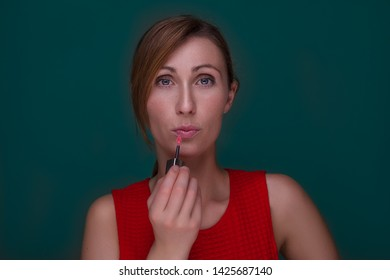 beautifying female with lip stick