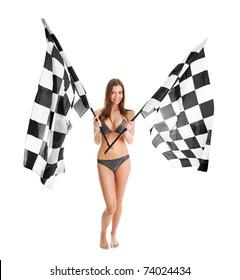 Beautilful girl waving racing flags