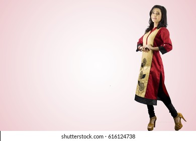 beautiul indian female model in red and gold kurti