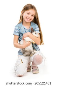 beautuful little girl with Easter bunny isolated on a white background