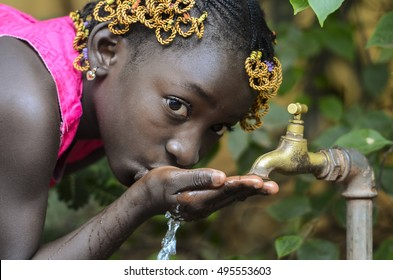 Beauty of Africa Drinking Clean Water from a Faucet