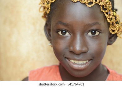 Beauty of Africa - Little African Girl Smiles Happily at the Camera. Gorgeous Black Beautiful Girl Showing Proud Africa Symbol.