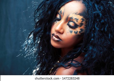 beauty afro girl with cat make up, creative leopard print closeup, fashion style halloween look