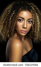 Beauty afro woman portrait posing on black background.