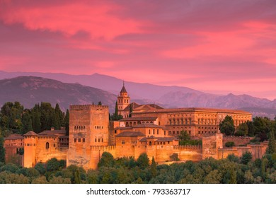 the beauty of the alhambra with the mountains of the sierra nevada in the background