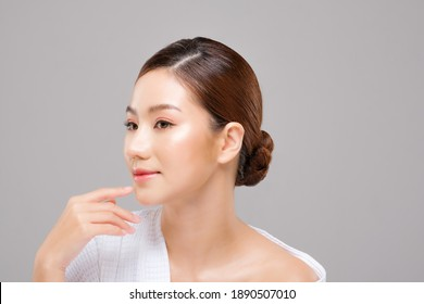 Beauty asian face of the young beautiful woman skin natural make up.  close up face pretty portrait spa and salon in bathing suit. beautiful skin care cosmetic concept