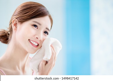 beauty asian girl clean her face with towel in the bathroom