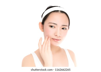 beauty asian girl who checks her skin. skin care. acne treatment.