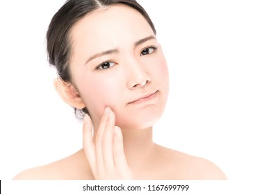beauty asian girl who checks her skin. skin care. acne treatment.