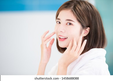 beauty asian skin care woman touch her face and smile to you