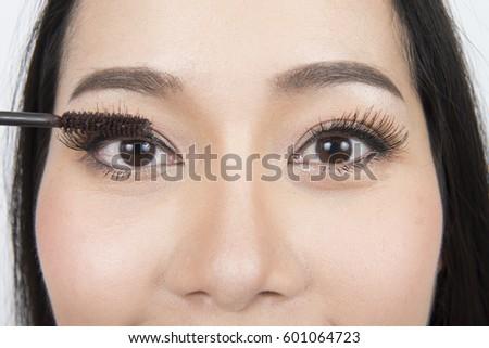 024737d50 Beauty asian woman applying makeup with Mascara. Beautiful asian woman face  and Perfect skin.
