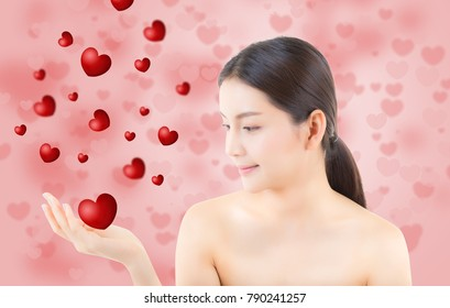 Beauty asian woman blowing mouth valentines heart with perfect make up, Girl showing love. Gestures for advertising cosmetic on yellow background.