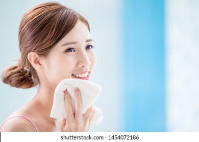 beauty asian woman dry her face with towel in the morning