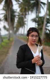 beauty asian woman happy traveling at park coconut trees. bangkok thailand. february 12, 2021