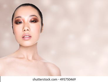 Beauty asian woman healthy cosmetic makeup portrait on beige bokeh background