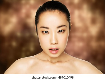 Beauty asian woman healthy cosmetic makeup portrait on orange yellow background