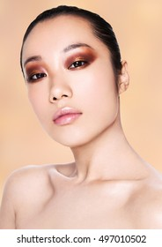 Beauty asian woman healthy cosmetic makeup portrait on beige background