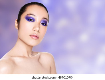 Beauty asian woman healthy cosmetic makeup portrait on purrple background