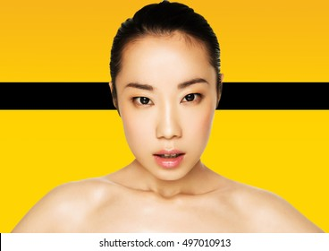 Beauty asian woman healthy cosmetic makeup portrait on yellow background with black stripe