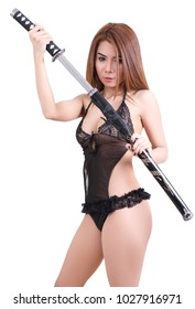 beauty asian woman in sexy clothes holding samurai