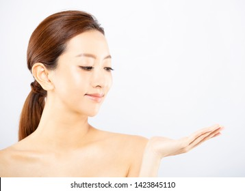 beauty Asian woman showing product on open hand