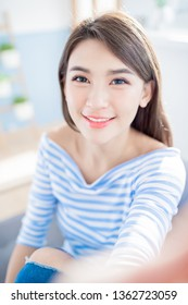 beauty asian woman take a selfie and smile happily at home