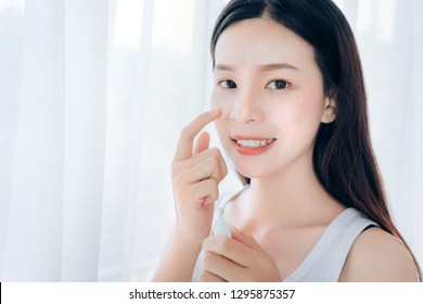 Beauty Asian Woman use Acne Gel Skincare after Cleansing on Face His Happiness,Copy Space.