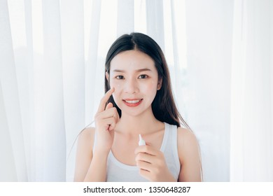 Beauty Asian woman use acne gel skincare after cleansing on face his happiness.