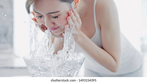 beauty asian woman wash her face in the morning