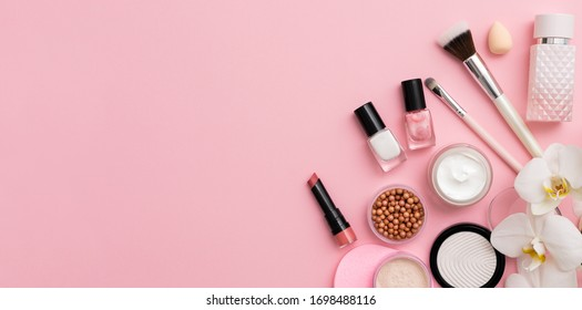 Beauty background with facial cosmetic products with empty copy space. Makeup, skin care concept with pastel colored background.