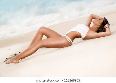 Beauty at the beach with blue sky and sand around