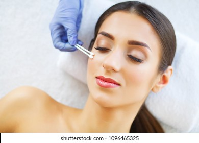Beauty. Beautiful Woman in Beauty Salon. Relax and Lying on the Massage Tables. Clean and Fresh Skin. High Resolution