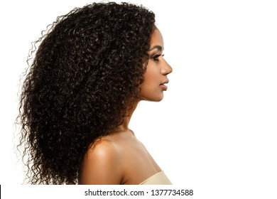 Beauty black skin woman African Ethnic female face. Young african american model with long afro hair. Lux model in profile