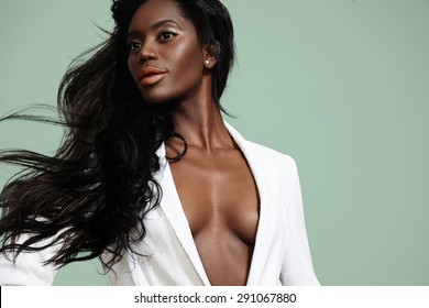 beauty black woman with a blowing hair