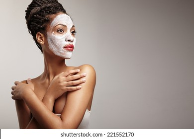 beauty black woman with a facial mask