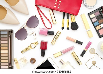Beauty blog fashion concept. Female styled accessories: cell phone, watches, sunglasses, cosmetics, shoes on white background.
