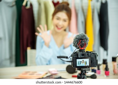 Beauty blogger video production for female fashion blog online cosmetic adviser record woman lifestyle tutorial. Trendy female vlogger showing how to use cosmetics products live via social media.