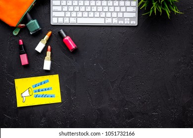 Beauty blogger workplace concept. Keyboard, cosmetics, social media icons on black desk top view space for text