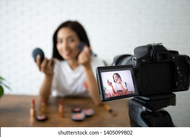 Beauty bloggers, Asian Women Showing cosmetic products while recording videos and giving advice for her beauty blog