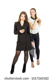 Beauty blonde businesswomen holding documents and interacting. Concept of teamwork.