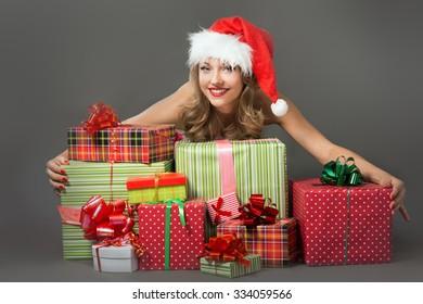 beauty blonde girl in santa hat on gray background