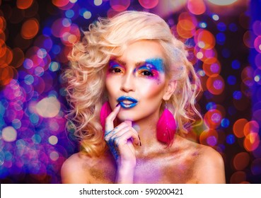 Beauty blonde woman face portrait with vivid makeup and stylish hairstyle. Fashion girl closeup. Bright Colors.