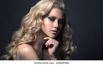 Beauty Blonde Woman Portrait. Beautiful model girl with curly blond hair. Hairdressing, hairstyle. Sexy Model. Perfect Skin and Make up.