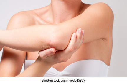 Beauty and Body care. Female elbow. Pain and health care concept.