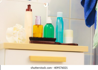 Beauty, body care, luxury and hygiene concept - bottles with liquid soap or body lotion cosmetics set in bathroom